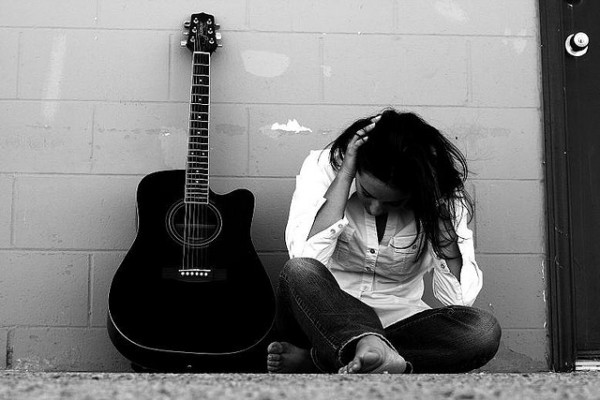 sad next to a guitar