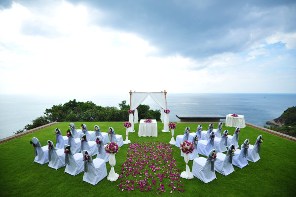 green and cloudy outdoor wedding ceremony ocean view