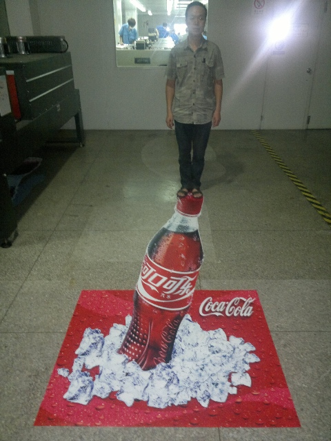 3D Coke Advertisement Creating Optical Illusion